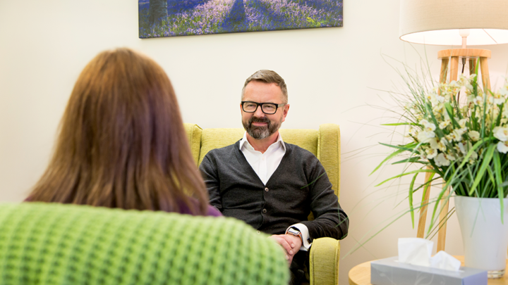Man smiling in a counselling room