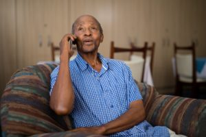 Old man smiling on telephone