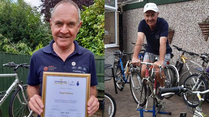 Man smiling with award and bike
